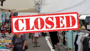 Εικόνα που απεικονίζει το εμποροπανηγύρι με μια κόκκινη σφραγίδα πάνω, που γράφει κλειστό στα αγγλικά (closed).
